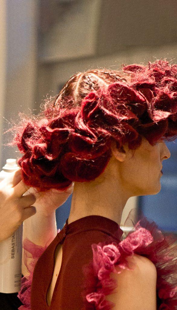 Pivot Point female model final trim on ornate hair design