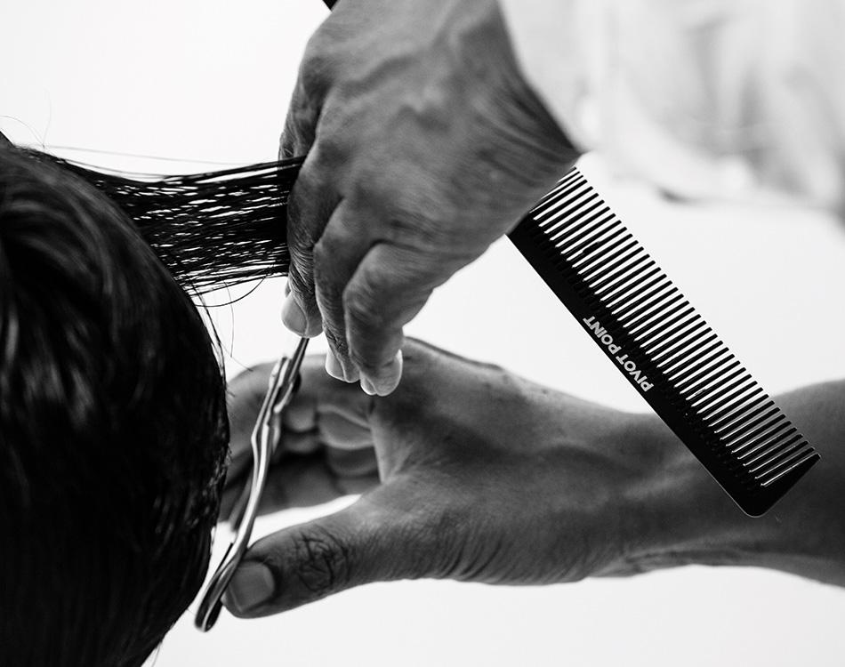 Stylist cutting client's hair