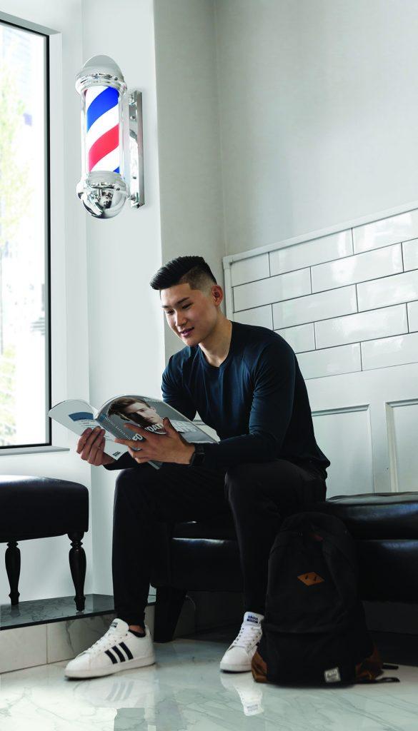 Pivot Point student reading Pivot Point Fundamentals: Barbering.