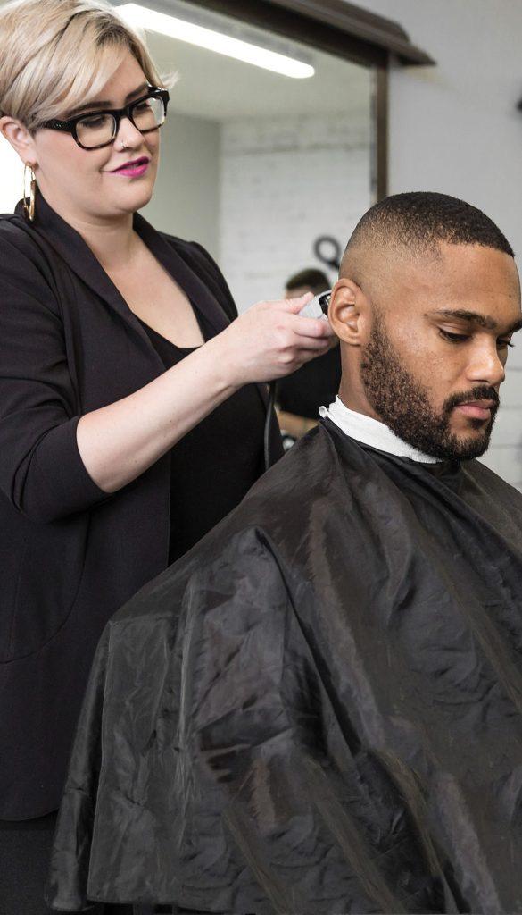 Pivot Point stylist completing a men's hair design