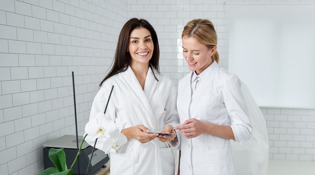 Pivot Point esthetician interacting with client