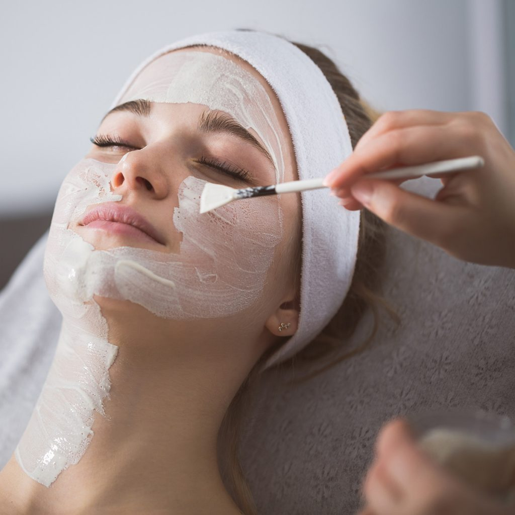 Pivot Point esthetician completing facial treatment with client