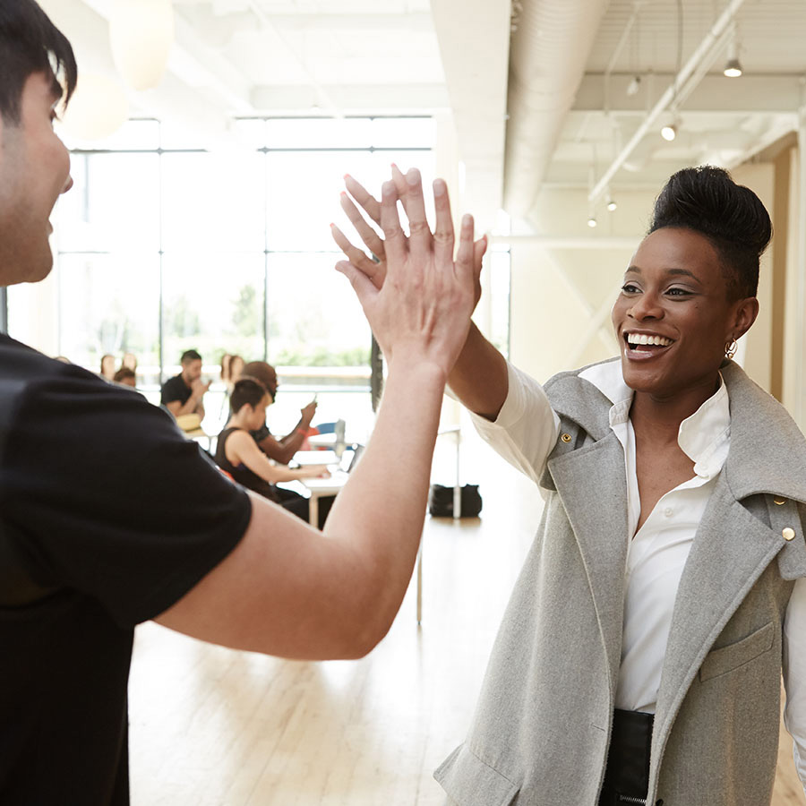 Pivot Point instructor high five with student