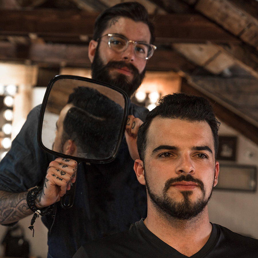 Pivot Point barber showing client results of cut