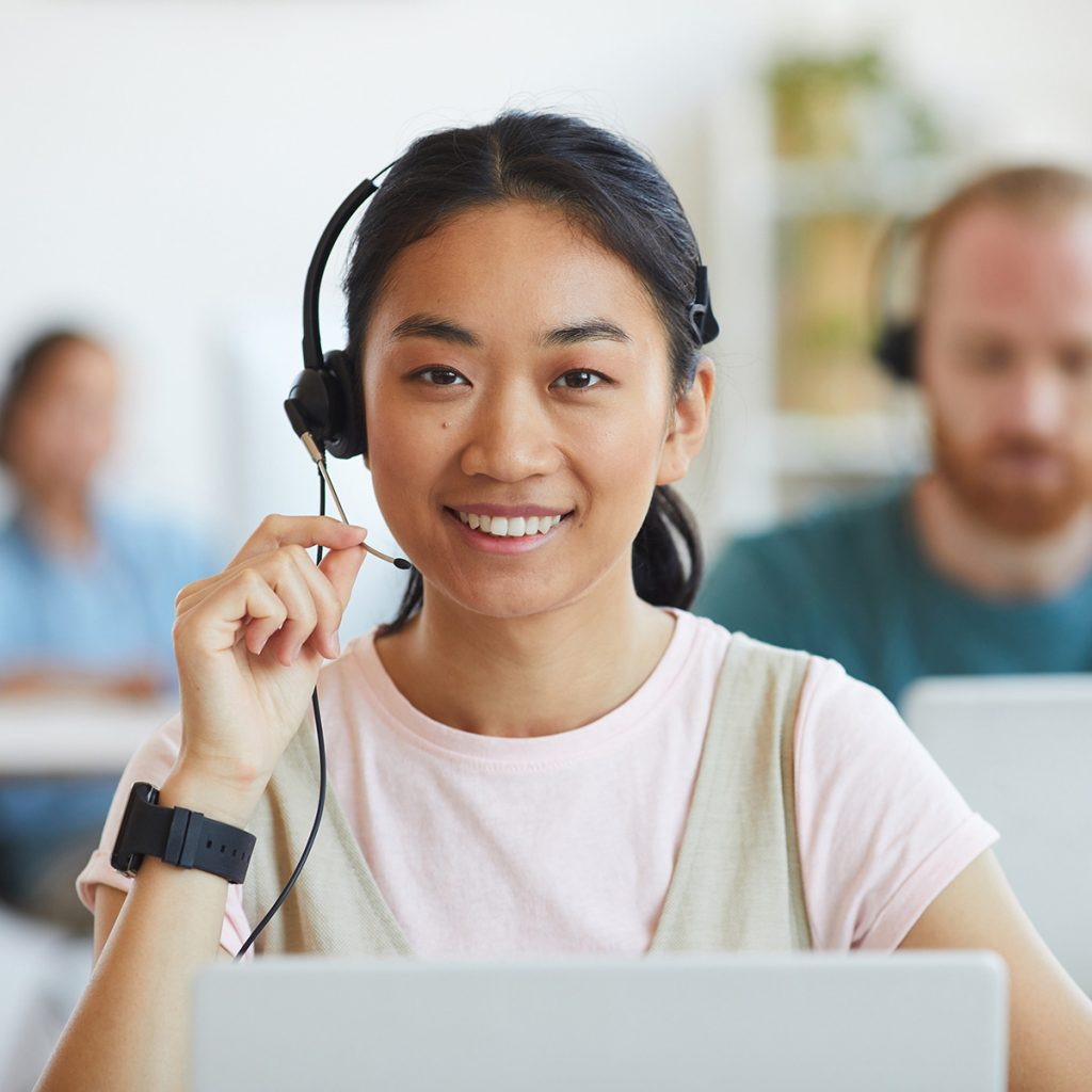 Young Asian female facing camera with smile during a virtual meeting