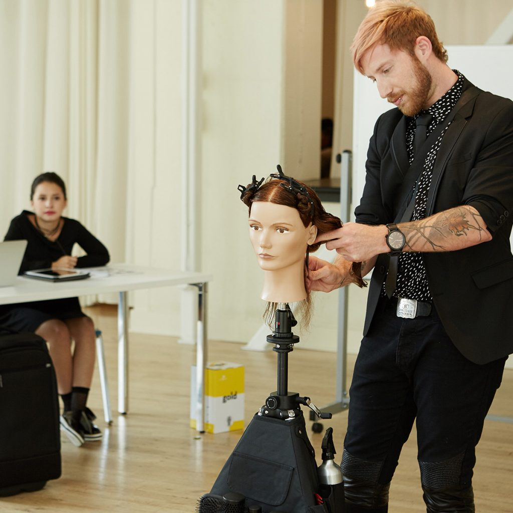 Pivot Point instructor demonstrating hairstyle techniques