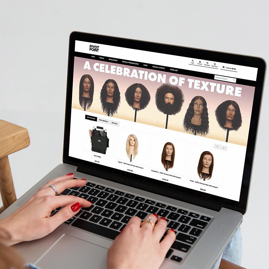 Woman checking Pivot Point Web Store with laptop