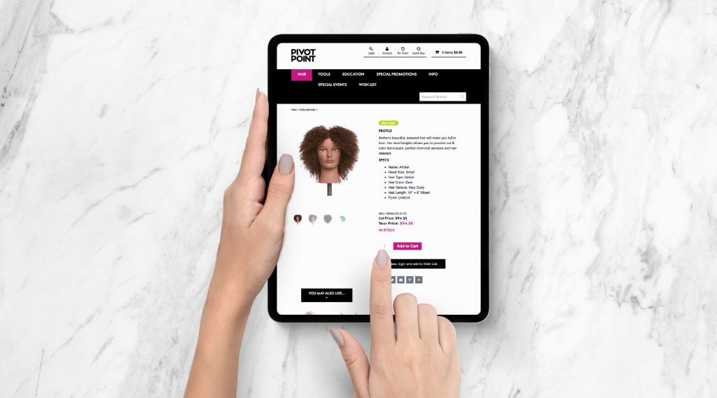 Woman checking Pivot Point Web Store with tablet