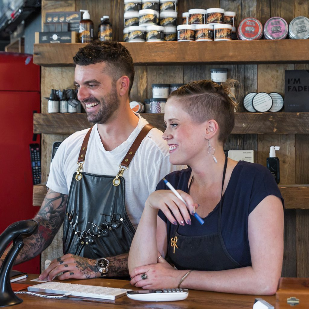 Two barbers ready to open shop