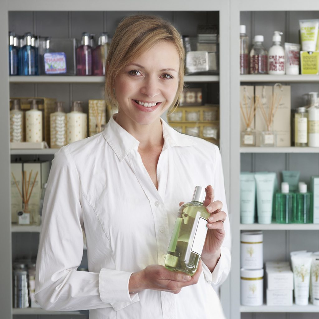 Esthetician recommending a product to a client.