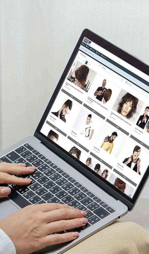 Woman using a laptop on a bean bag