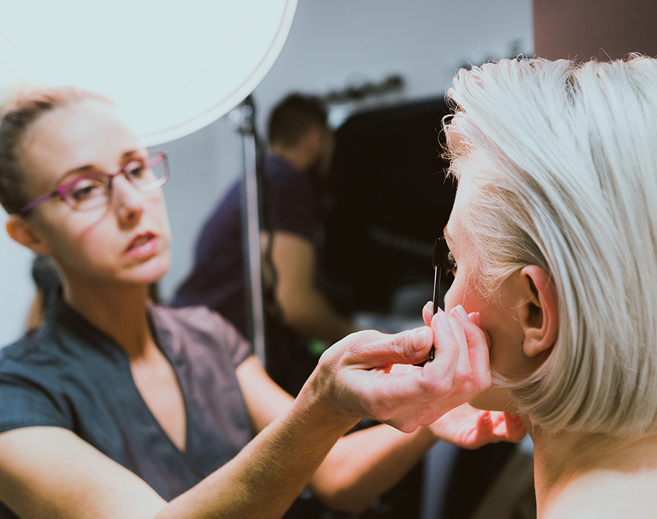 A stylist making finishing touches for a photo shoot.