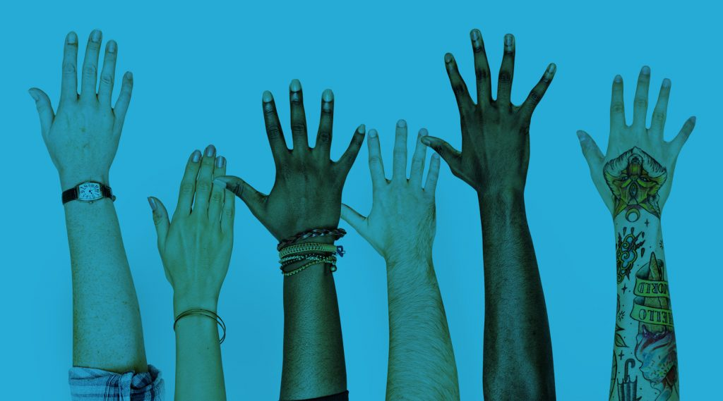 Multi-Ethnic hands in the air