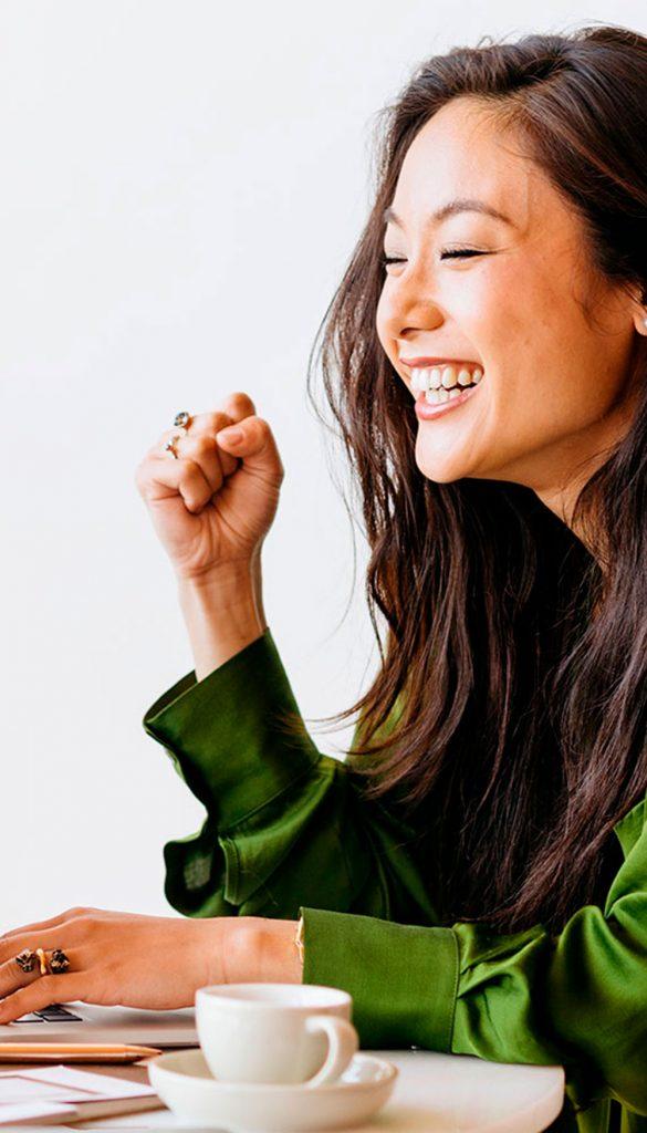 Smiling asian woman working